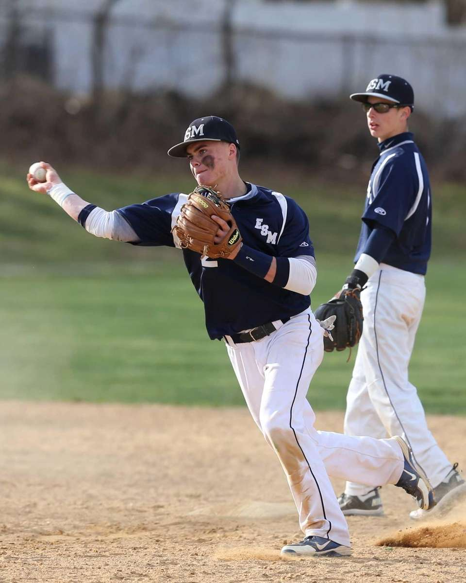 Eastport/South Manor Michael Flynn makes the throw to