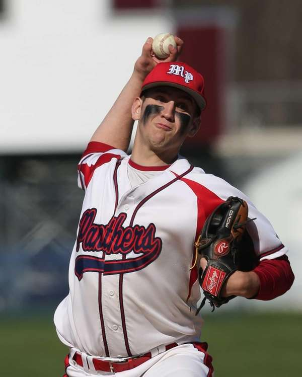 Miller Place's Cody McPartland delivers a pitch during