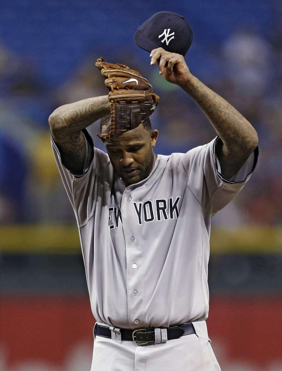 CC Sabathia reacts as he struggles during the