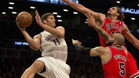 Brook Lopez looks to pass the ball while