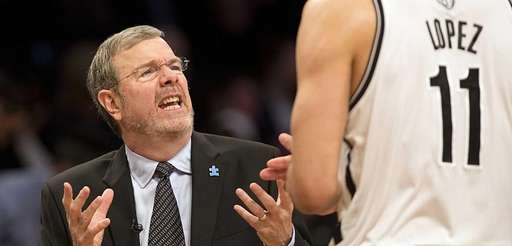 Nets interim head coach P.J. Carlesimo talks with