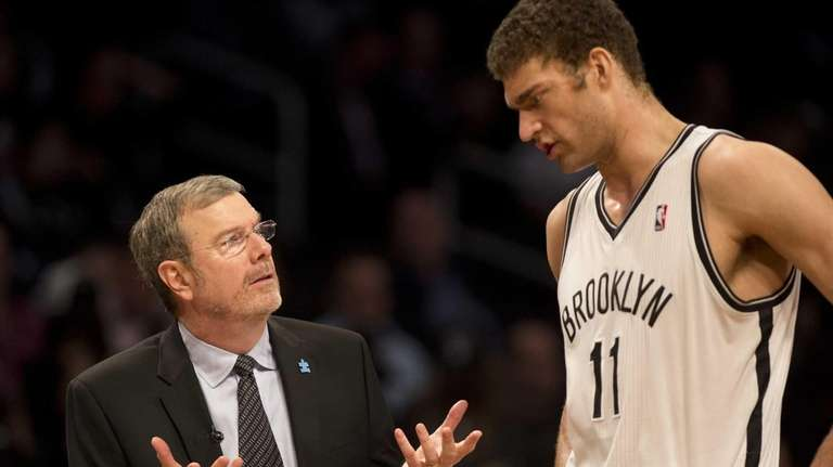 Nets' interim head coach P.J. Carlesimo talks to