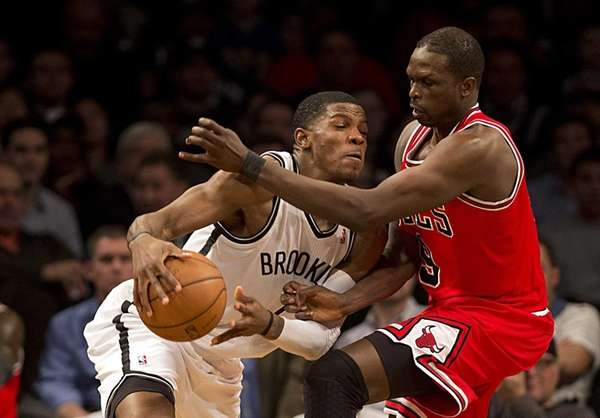 Joe Johnson tries to fight through the defense