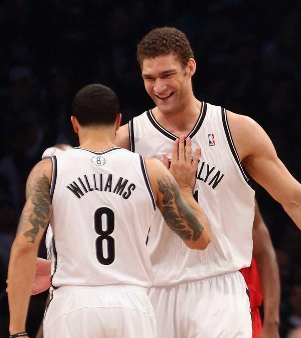 Brook Lopez and Deron Williams celebrate a basket