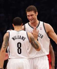Brook Lopez and Deron Williams celebrate a basket