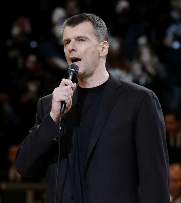Mikhail Prokhorov talks to the crowd before Game