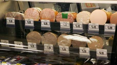 Meats are seen in a deli display at