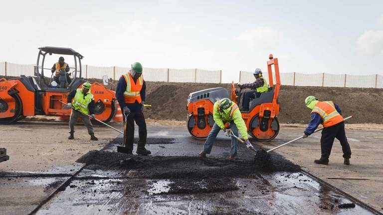 Construction crews work on sections of Ocean Parkway