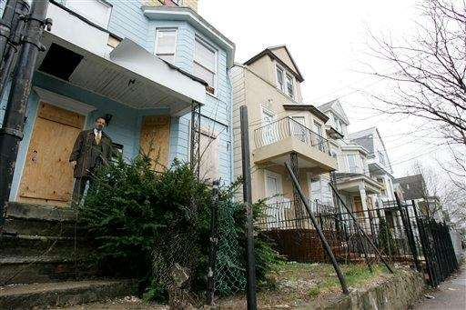 Michael Meyers, Newark's housing director, stands on the