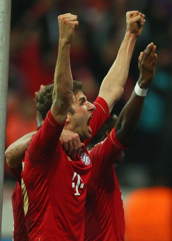 Thomas Mueller of Bayern Munich celebrates after scoring