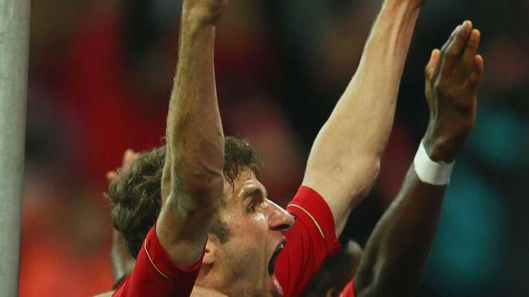 Thomas Mueller of Bayern Munich celebrates after scoring
