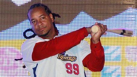 Former MLB star Manny Ramirez poses for media