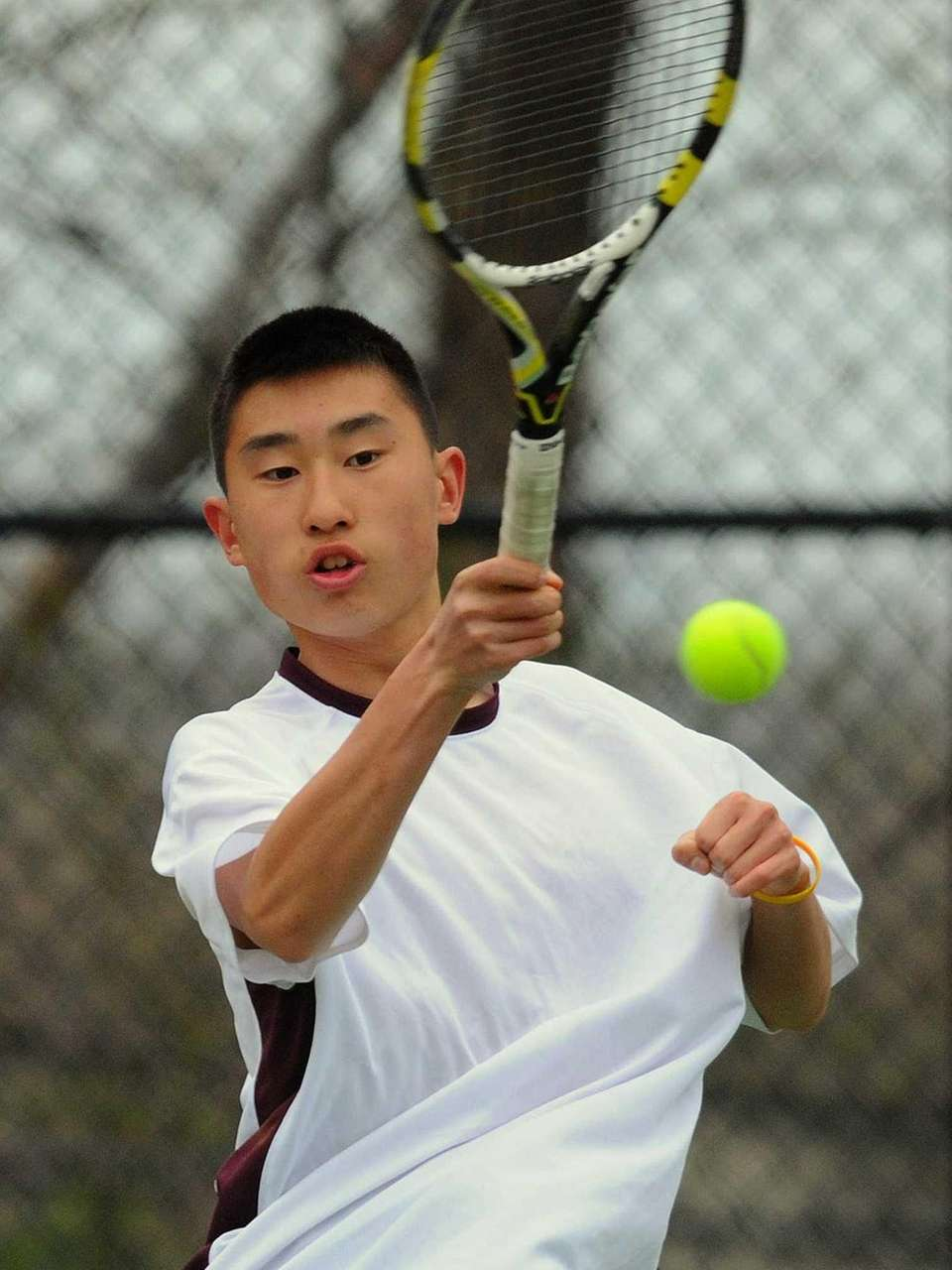 Whitman's Justin Park returns a volley in a