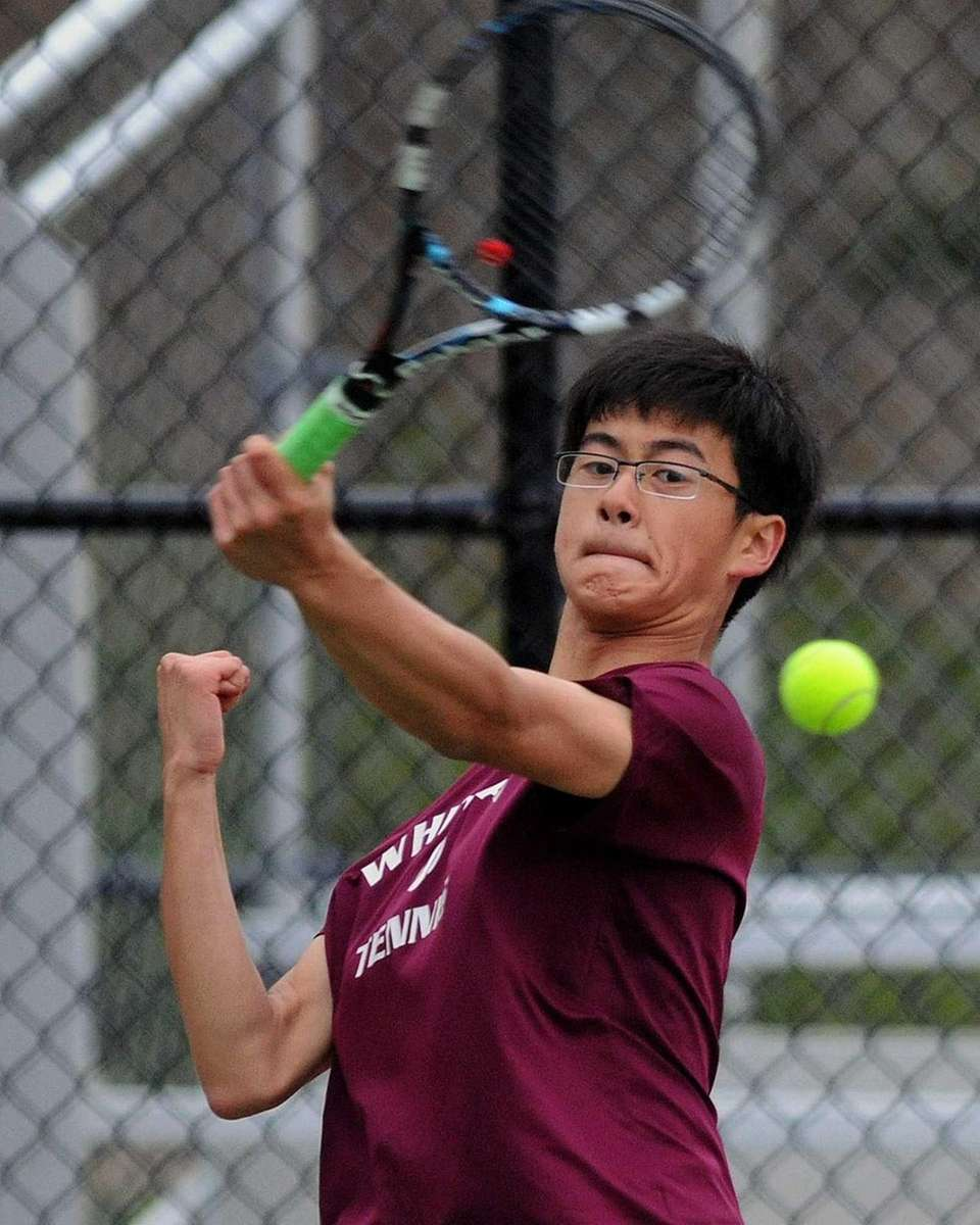 Whitman's Joon Ko returns a volley in a
