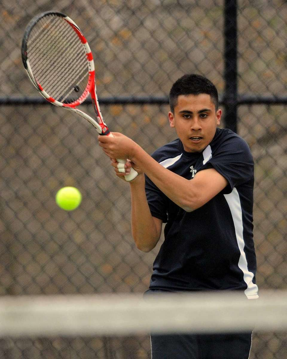 Half Hollow Hills East's Zain Ali returns a