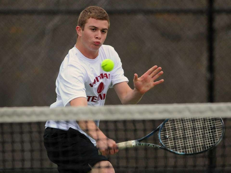 Whitman's Brandon Stone returns a volley in a