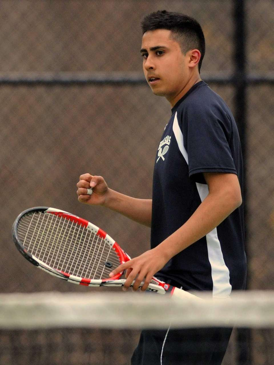 Half Hollow Hills East's Zain Ali reacts after