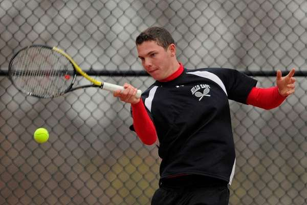 Half Hollow Hills East's Jeff Cherkin returns a