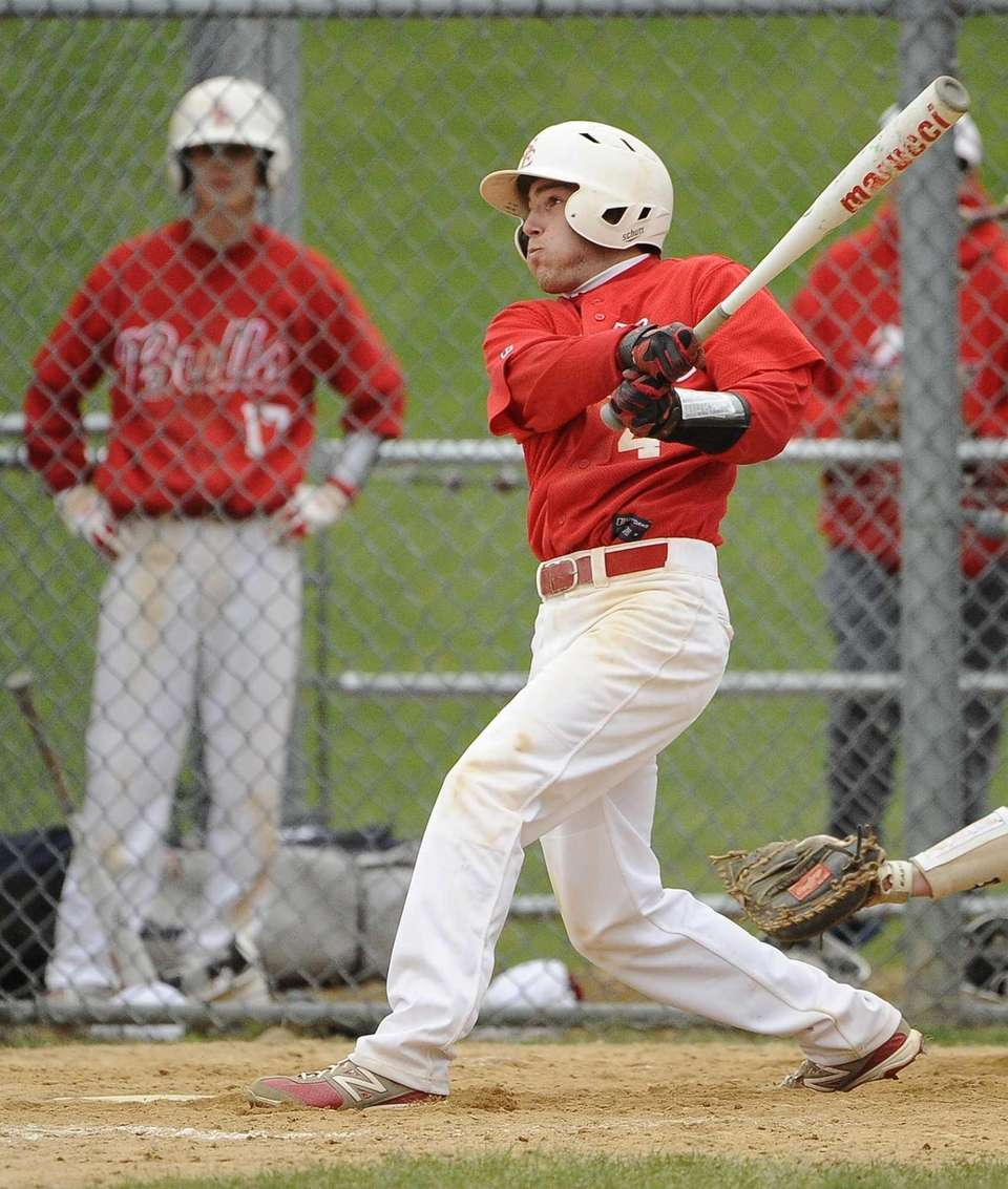 Smithtown East's Nick Auricchio follows through on his