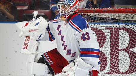 Martin Biron warms up before a game against