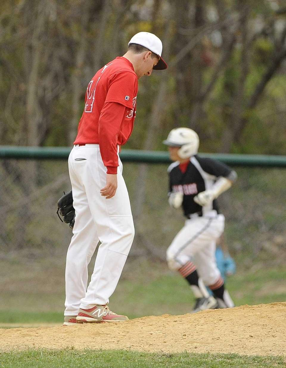 Smithtown East starting pitcher Dimitri Lettas reacts as