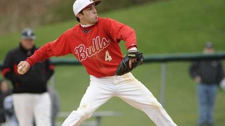 Smithtown East relief pitcher Nick Auricchio delivers in
