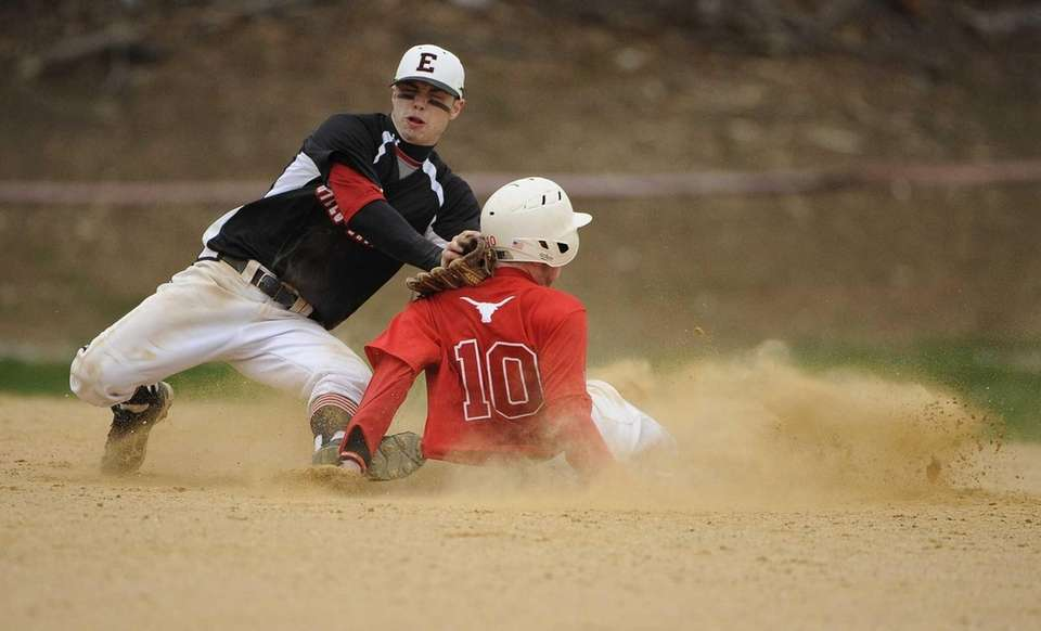 Smithtown East's Matt Kelly steals second base against