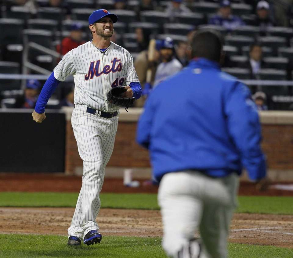 Jonathon Niese reacts after being hit with a