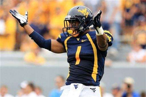 West Virginia wide receiver Tavon Austin (1) gestures