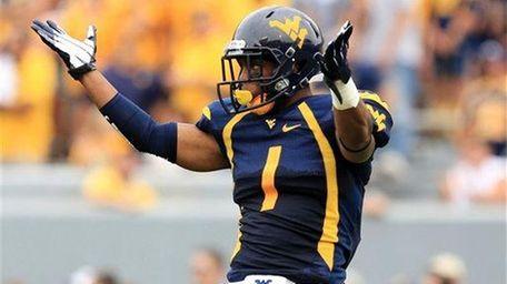 West Virginia wide receiver Tavon Austin (1) gestures