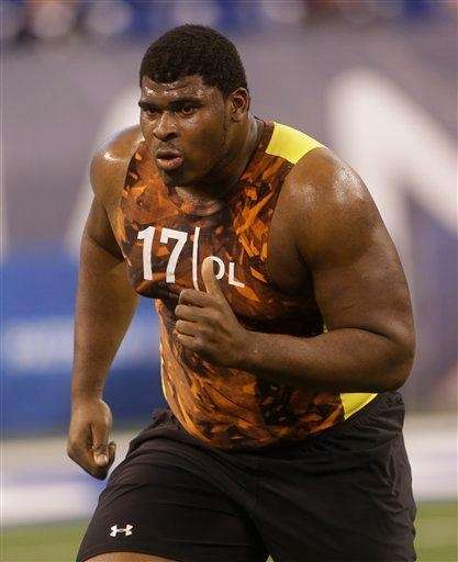 Alabama offensive lineman D.J. Fluker runs a drill