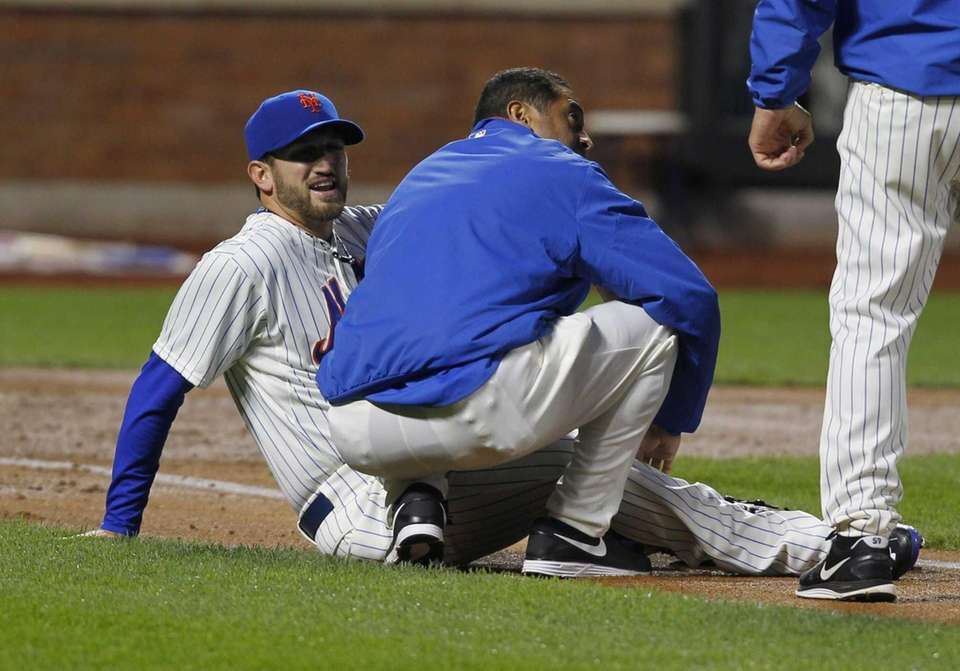 Jonathon Niese is attended to after being hit