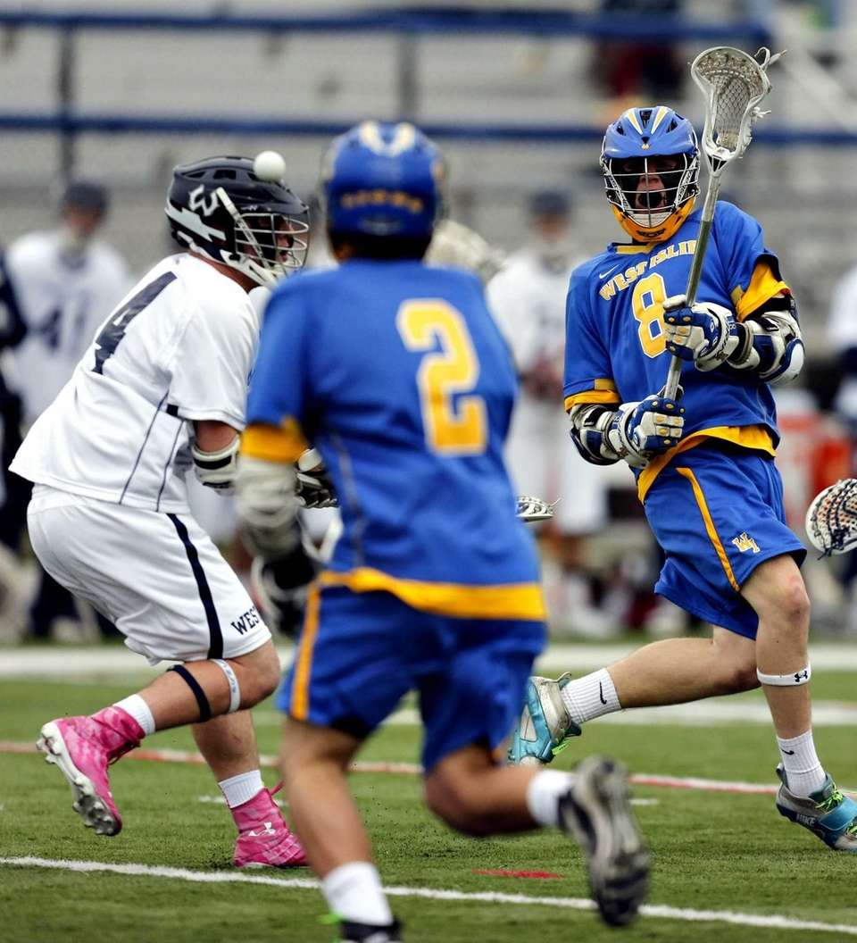West Islip's Trevor Bovich passes to Ryan Wieczorek
