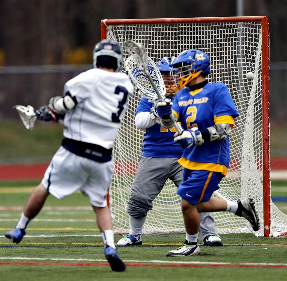 Smithtown West's George Schultz shoots on goal in