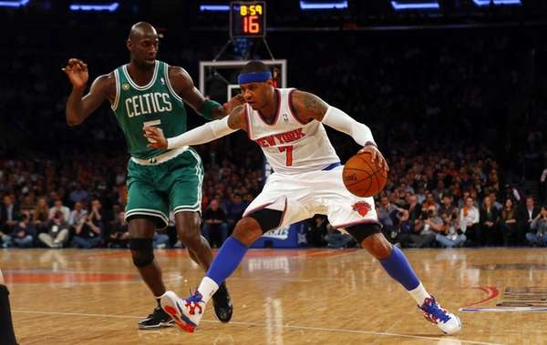 Carmelo Anthony drives against Boston Celtics forward Kevin