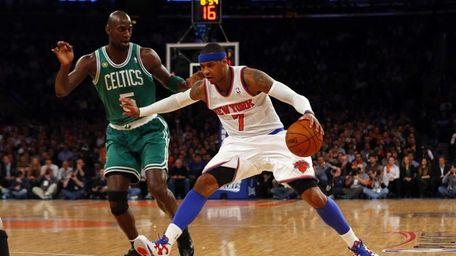 Carmelo Anthony drives against Boston Celtics forward Kevin
