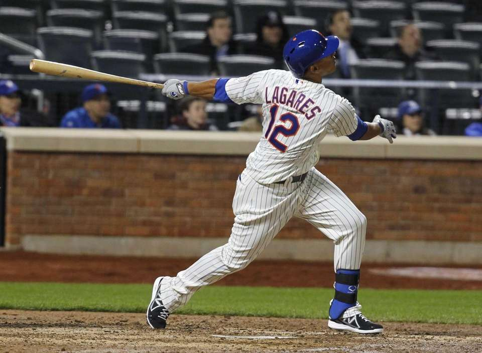 Juan Lagares flys out to left in his