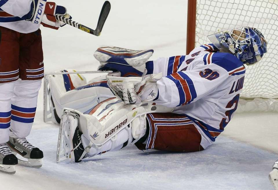 Rangers goalie Henrik Lundqvist reacts after allowing a