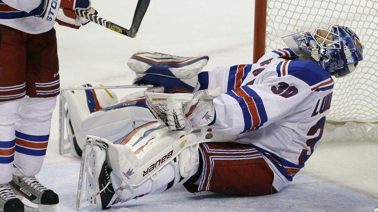 Rangers goalie Henrik Lundqvist reacts after allowing a