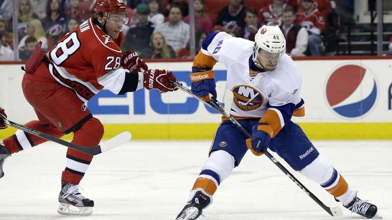 Islanders' Michael Grabner controls the puck as Carolina