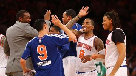 J.R. Smith celebrates after hitting a three-point shot