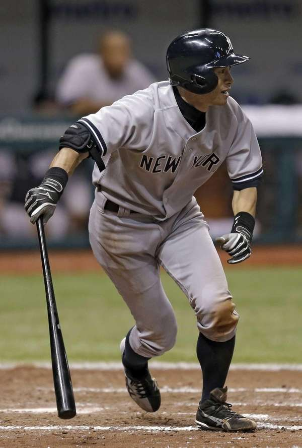 Ichiro Suzuki follows through on his ninth-inning, two-run