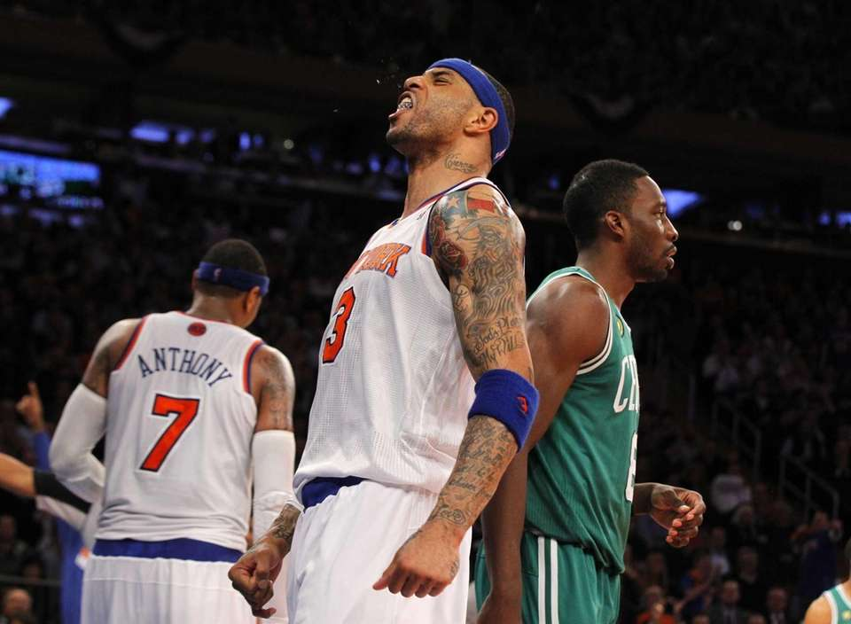 Kenyon Martin reacts after blocking a shot against