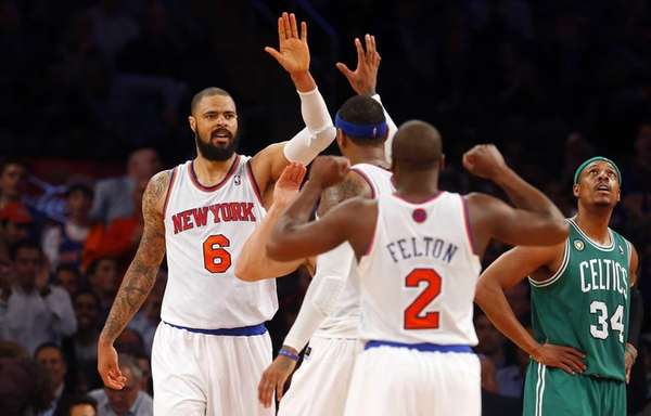 Tyson Chandler celebrates a basket with his teammates