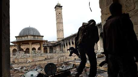 Syrian rebel fighters in Aleppo's Umayyad Mosque complex