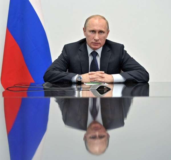 Russian President Vladimir Putin speaks during a video