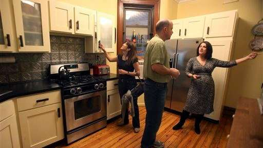 Prospective buyers speak to a Corcoran Group Real