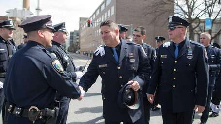 Nassau County Police Officer James McDermott shakes hands
