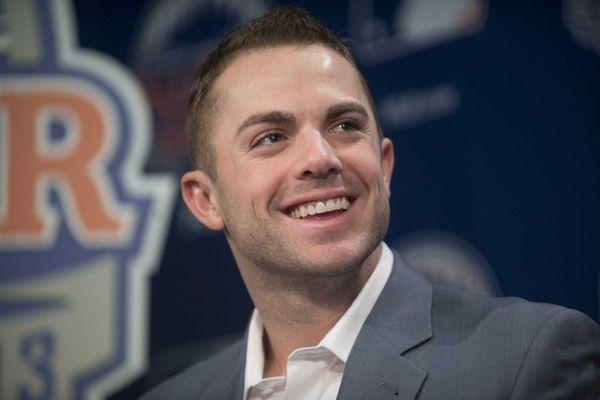 Mets captain David Wright listens as Mayor Bloomberg
