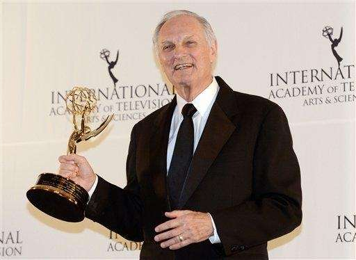 Alan Alda poses after winning a Special Founders